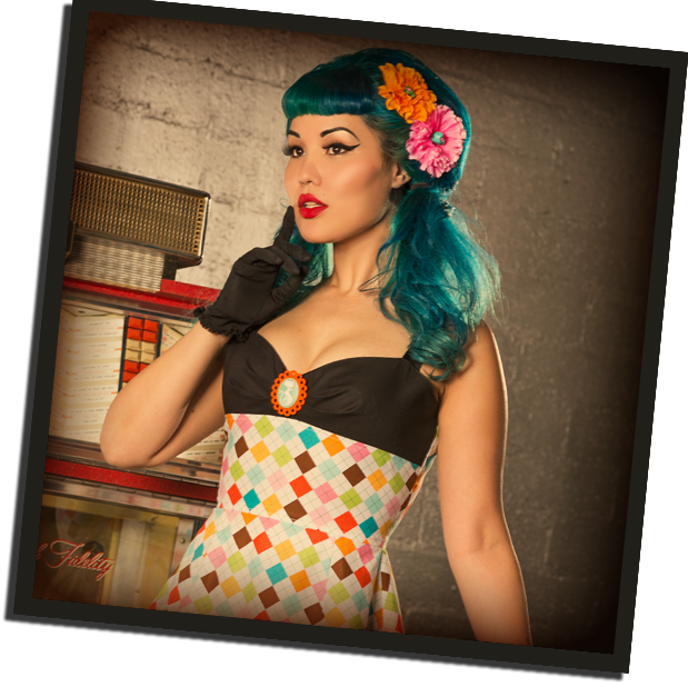 Foxy Moxie dress in Argyle with Retro Kitty Cameo and Sugar Skull Flowers, modeled by Moxie Macabre | Poison Candy